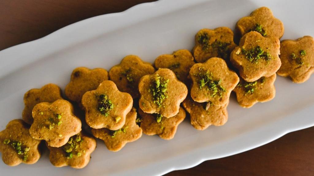 طرز تهیه شیرینی نخودچی خانگی خوشمزه و ترد مجلسی مخصوص عید