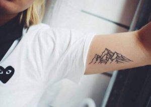 طرح تاتو ظریف دخترانه روی بازو کوه