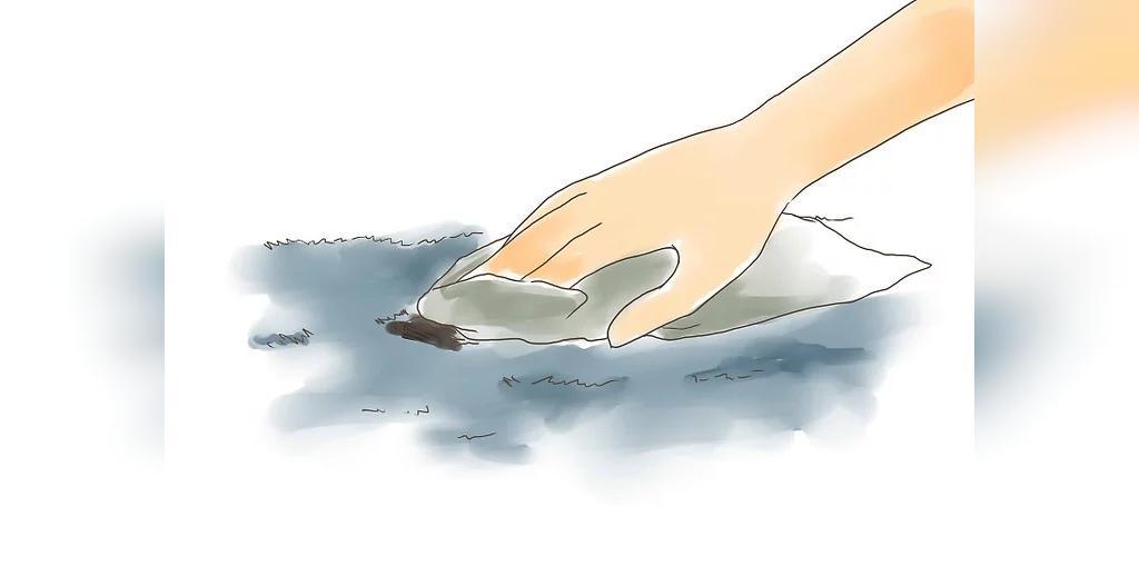 لکه جوهر را با یک پارچه سفید و تمیز خشک کنید