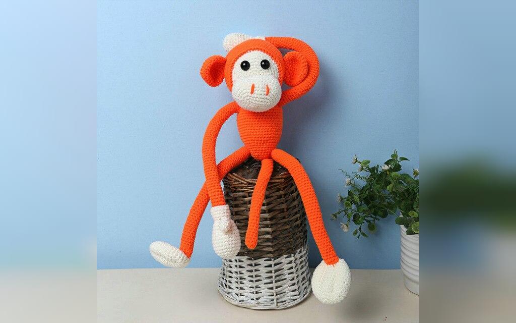 عکس عروسک بافتنی طرح میمون نارنجی